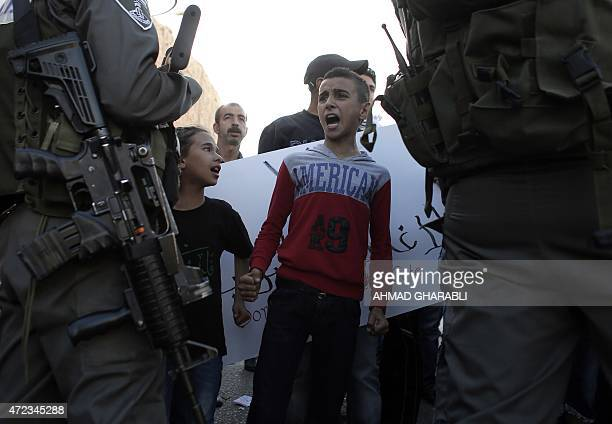 A Palestinian boy shouts slogans during a protest in the West Bank village of AlZaayem east of Jerusalem on May 6 to protest against the Israeli...