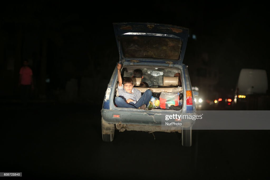 A Palestinian boy Sitting in a car boot on a street in Gaza City, August 19, 2017.