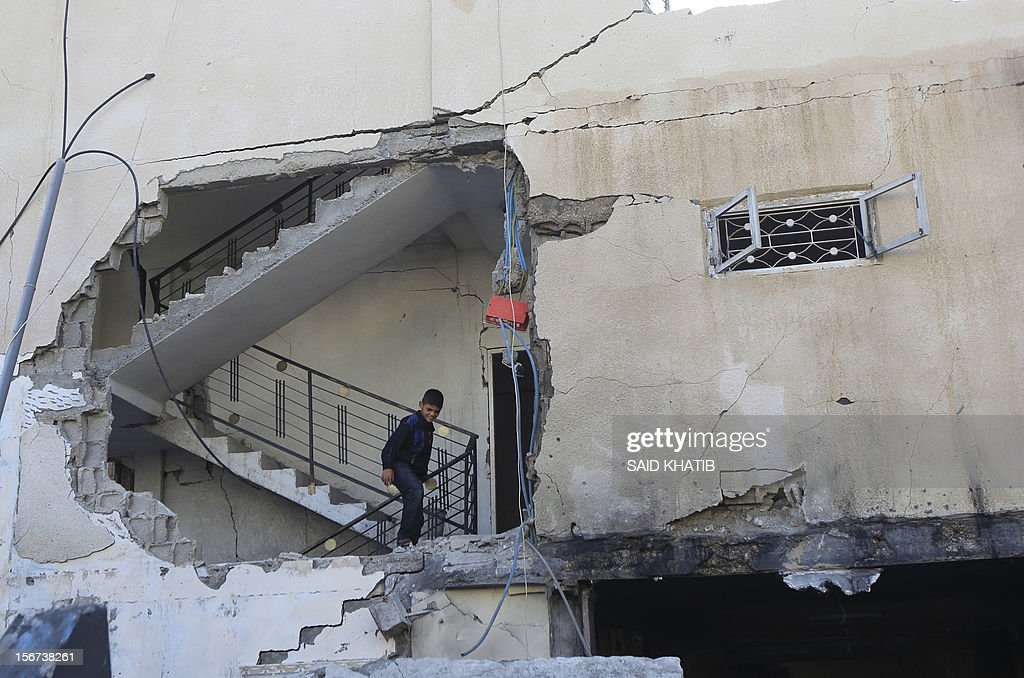 A Palestinian boy walks up the stairs of a damaged house following overnight Israeli air strikes on the southern Gaza Strip town of Rafah on November 20, 2012. The Israeli military said it attacked about 100 targets in the coastal strip during the night, using aircraft, warships and artillery.
