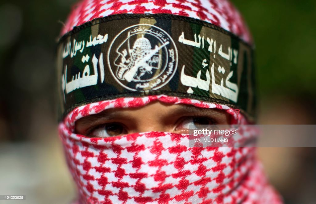 A Palestinian boy wearing a headband of the Ezzedine al-Qassam Brigades, Hamas' armed wing, takes part in a rally in Gaza City on August 27, 2014, following a deal hailed by Israel and the Islamist movement as 'victory' in the 50-day war. The agreement, effective from 1600 GMT on August 26, saw the warring sides agree to a 'permanent' ceasefire which Israel said would not be limited by time, in a move hailed by Washington, the United Nations and top world diplomats.
