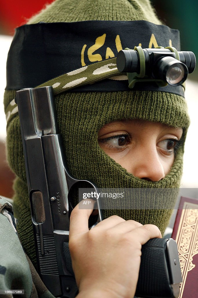 A Palestinian boy wearing army-style fatigues holds a gun during a demonstration in the Palestinian refugee camp of Ain el-Helweh on the outskirts of the southern Lebanese city of Sidon on November 16, 2012, against Israel's military operation in the Gaza Strip. Thousands of people across the Middle East protested on Friday against Israel's aerial bombardment of the Gaza Strip, with some chanting 'death to Israel' and others calling for the bombing of Tel Aviv.