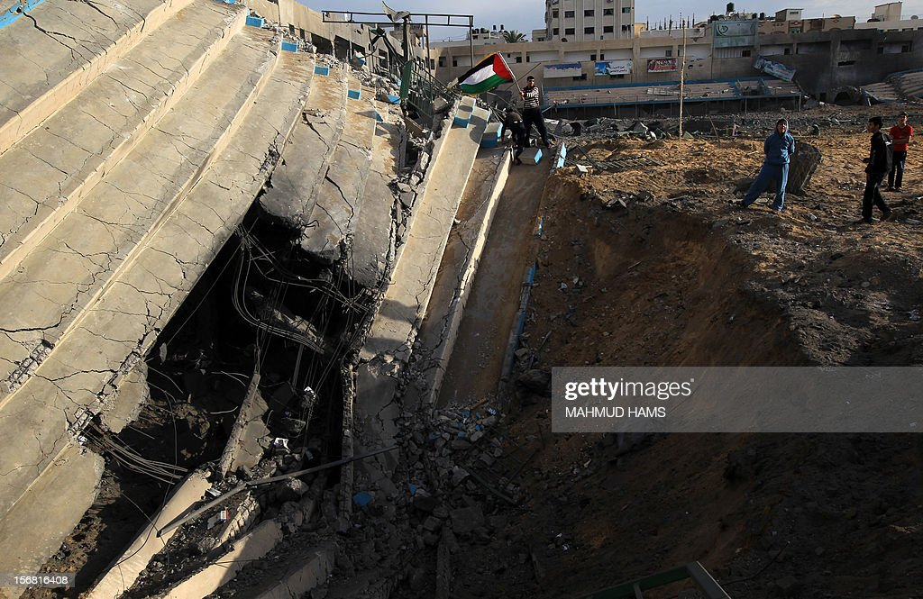 Palestinian boys inspect the debris of the destroyed Palestine Sports Stadium in Gaza City on November 22, 2012, after a ceasefire took hold in and around Gaza after a week of cross-border violence between Israel and Palestinian militants that killed at least 160 people.