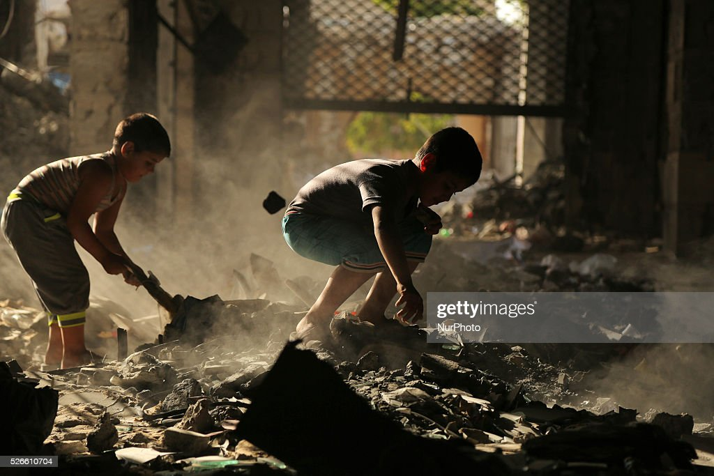 Palestinian boys play on the rubbles of houses, which were destroyed during the recent Israeli war 2014, in Gaza city, on April 30, 2016. Israels punitive ban on cement imports into the Gaza Strip has prevented hundreds of families from rebuilding their homes devastated by the 2014 war, the UN Office for the Coordination of Humanitarian Affairs (OCHA) said in a press release Thursday.