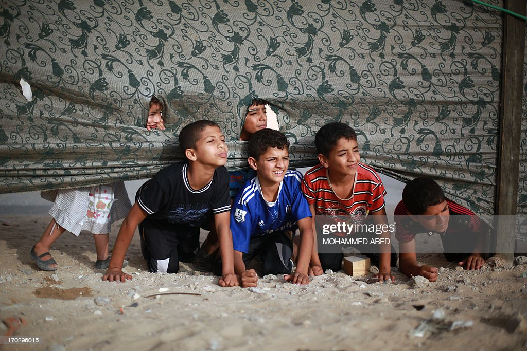 Palestinian boys take a break during a summer physical training camp run by Hamas during their summer vacation in Gaza City on June 10, 2013.