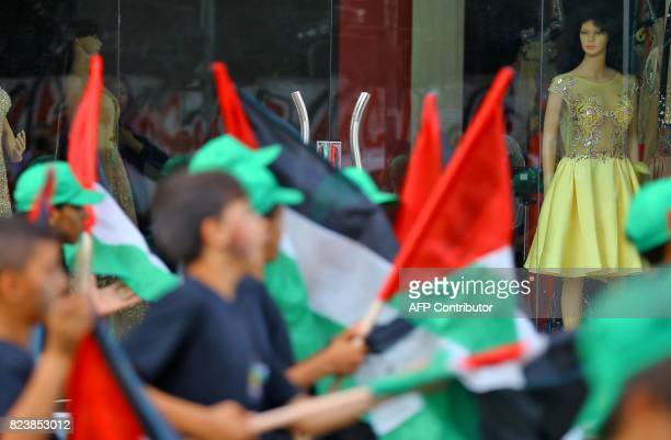 Palestinian boys take part in a rally organised by Hamas movement in Gaza City on July 27 after a boycott of two weeks ended against entering the...