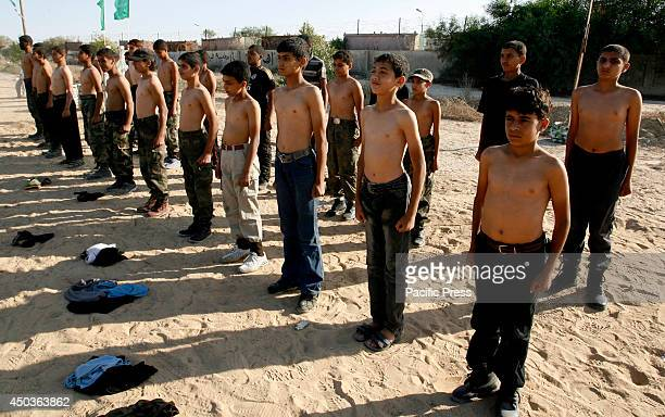 Palestinian boys take part in a semimilitary exercise during a summer camp organized by the Hamas movement in Rafah in the southern Gaza Strip...