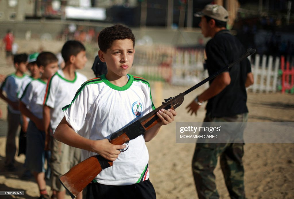 Palestinian boys take part in a summer physical training camp run by Hamas during their summer vacation in Gaza City on June 10, 2013.