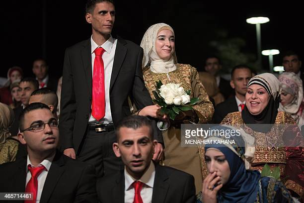 Palestinian brides and grooms take part in a mass wedding ceremony in the West bank city of Jericho on Januray 28 2014 Nearly 300 Palestinians were...