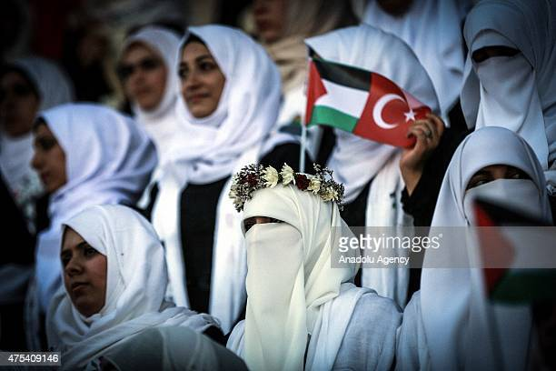 Palestinian brides attend a mass wedding ceremony at the Yarmouk Stadium in Gaza on May 31 2015 Two thousand couples got married in the ceremony...