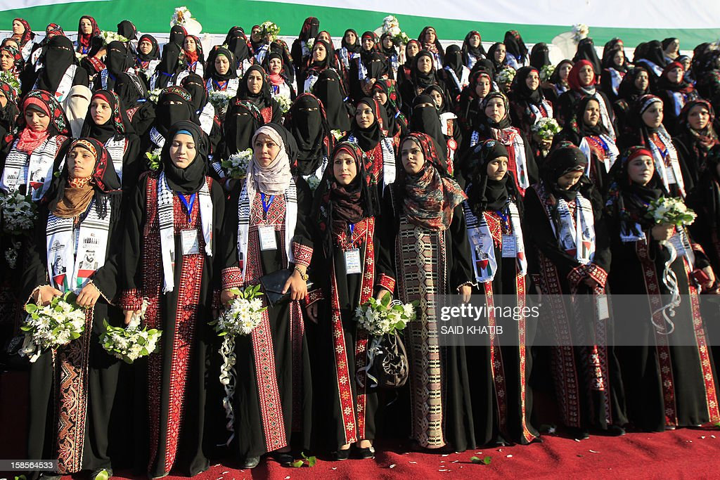 Palestinian brides take part in a mass wedding ceremony in Rafah, southern Gaza Strip, on December 19, 2012. Some 436 couples in need participated to the mass wedding organized by the National Islamic Committee in the Gaza Strip and other financial donations.