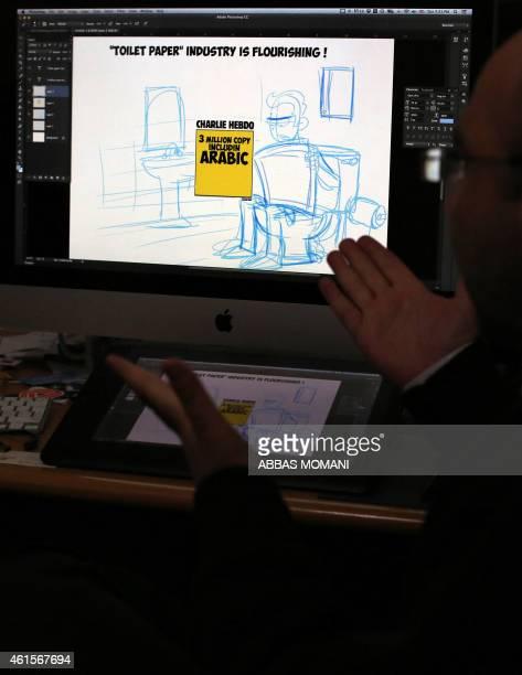 DAVISON Palestinian cartoonist Ramzy Taweel answers AFP journalists' questions in front of a computer displaying one of his drawing on January 13...