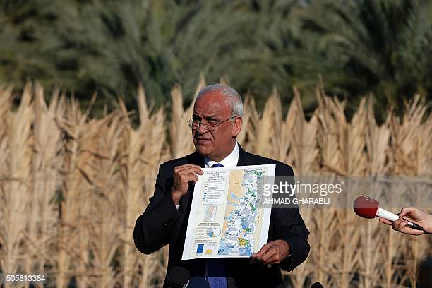 Palestinian chief negotiator and Secretary General of the Palestine Liberation Organisation Saeb Erekat shows a map as he addresses journalists on...