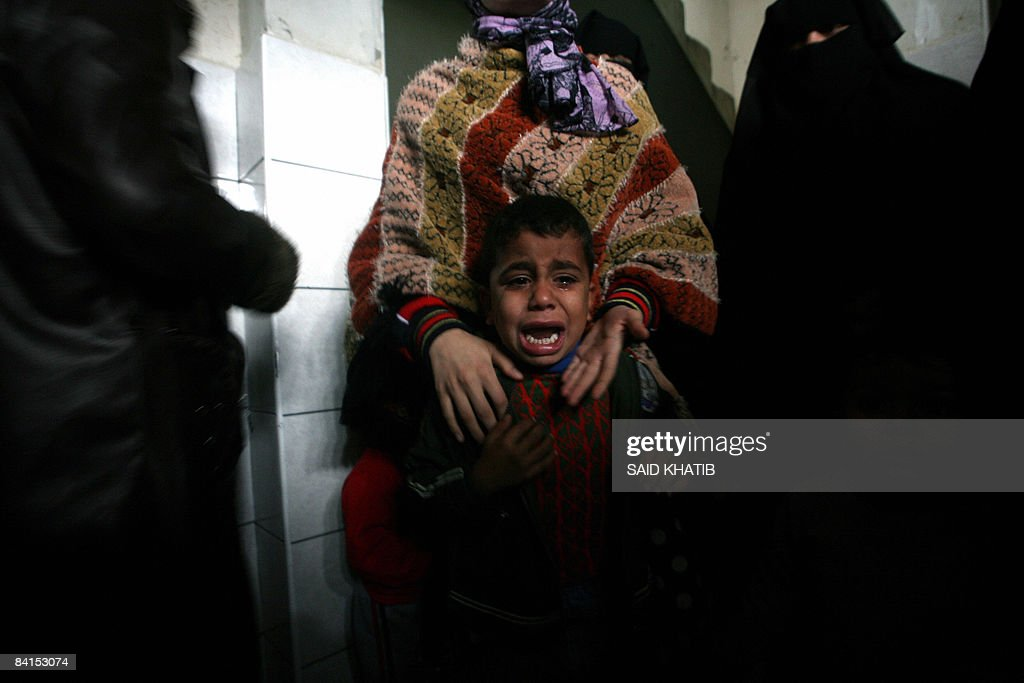 A Palestinian child cries during the funeral of a Palestinian civilian who was killed in an Israeli air strike targeting the house of a Hamas militant in the southern city of Rafah on January 1, 2008 in the southern Gaza Strip. Israel launched the New Year with fresh air strikes on Gaza that took the death toll from its blitz on Hamas to 400 as international efforts to secure a truce foundered
