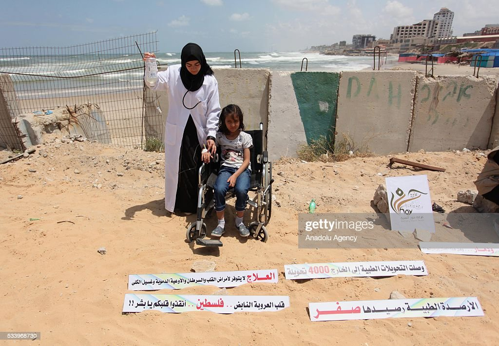 A Palestinian child demands lifting the blockade of Israel due to inability on health services during a demonstration demanding lifting the blockade of Israel in Gaza City, Gaza on May 24, 2016.