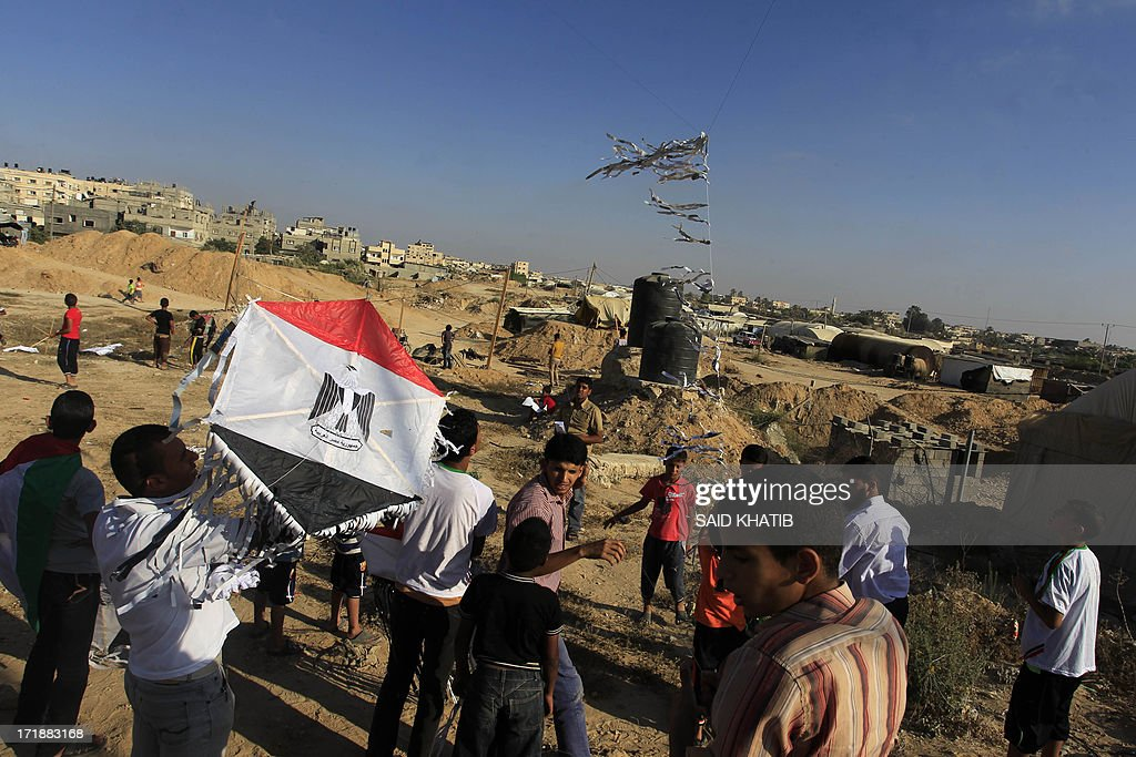A Palestinian child holds a kite bearing the Egyptian flag in solidarity with the country during an event organised by Hamas in Rafah town, in the southern Gaza Strip on June 29, 2013. AFP PHOTO/ SAID KHATIB