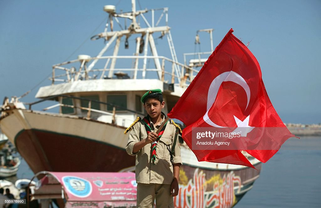 Palestinian child holds Turkish flag during a commemoration ceremony organized by IHH Humanitarian Relief Foundation for those who lost their lives in 2010 Mavi Marmara flotilla incident, in Gaza City, Gaza on May 31, 2016.