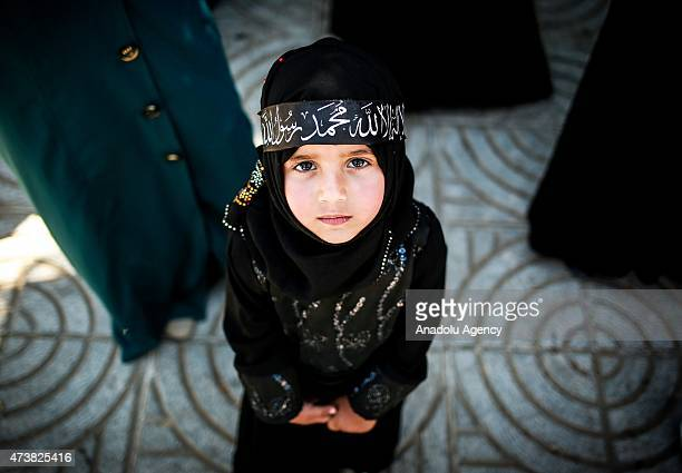 Palestinian child is seen during a march toward unknown soldier's memorial demanding reconstitution Islamic caliphate which is abolished 91 years ago...