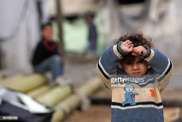 Palestinian child stands next to her home inside the Buffer or 'nogo' zone imposed by Israel December 29 2005 in Beit Lahia village northern Gaza...
