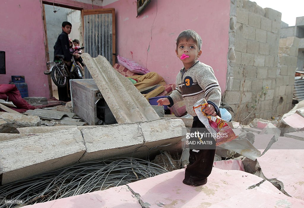 A Palestinian child stands on the rubble of a home following an Israeli military air strike in Rafah town in the southern Gaza Strip, on November 11, 2012. The flare-up which began November 10, was one of the most serious since Israel's devastating 22-day operation in the Gaza Strip over New Year 2009, has culminated in six Palestinians being killed and 32 injured by Israeli strikes after militants fired on an Israeli jeep, wounding four soldiers, medics and witnesses said.