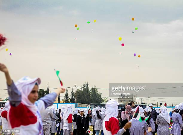 Palestinian children and girls students in UNRWA schools for refugees in Gaza shooting balloons of hope and welcome the Japanese people and to...