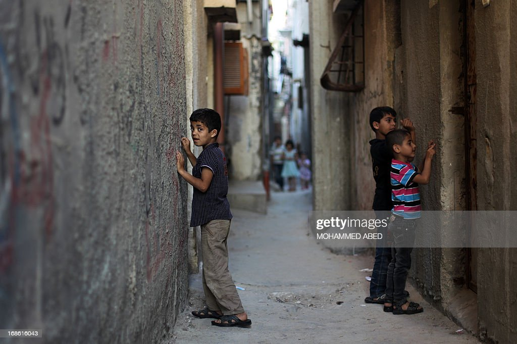 Palestinian children draw on the walls next to their homes in Gaza City, on May 12, 2013. On May 15, Palestinians will mark Nakba, or catastrophe, which commemorates the exodus of hundreds of thousands of Palestinians after the establishment of Israel state in 1948.