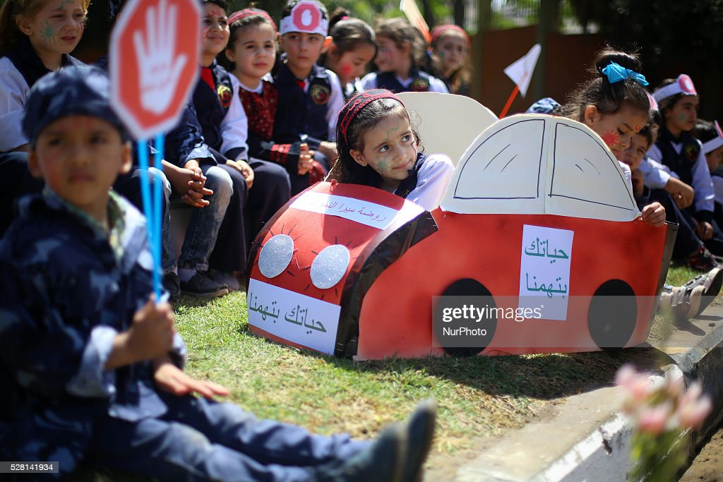 Palestinian children during rally International Day of Traffic in Gaza City , on May 4, 2016