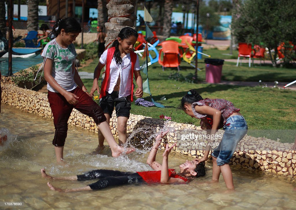 Palestinian children enjoy summer camp activities at a public park in Gaza City on June 12, 2013. AFP PHOTO/MOHAMMED ABED