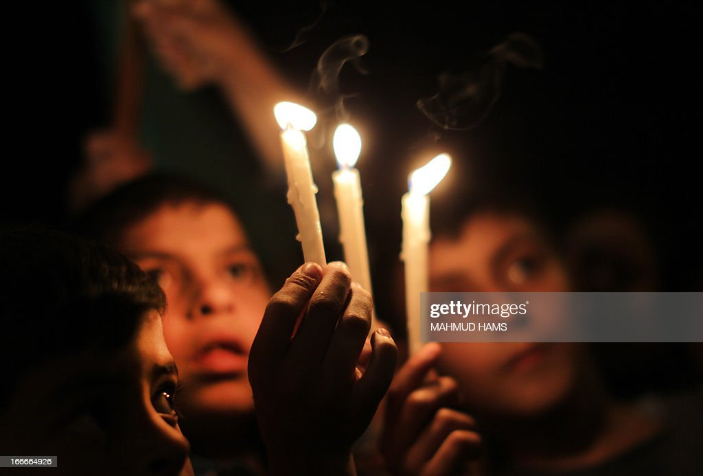 Palestinian children hold a candle light vigil to show solidarity with Palestinian prisoners held in Israeli jails, on April 15, 2013 in Gaza City. Human rights violations by medics working for Israel's prison service are endangering the lives of both Israeli and Palestinian inmates, especially hunger strikers, a watchdog said on April 11.