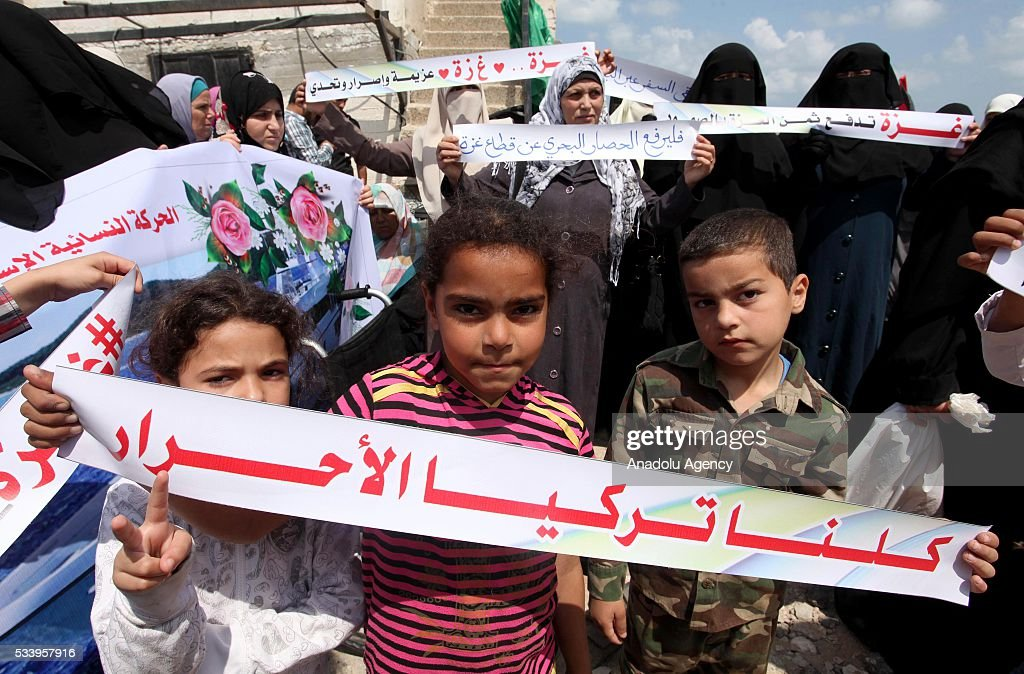 Palestinian children hold banners during a demonstration demanding lifting the blockade of Israel in Gaza City, Gaza on May 24, 2016.