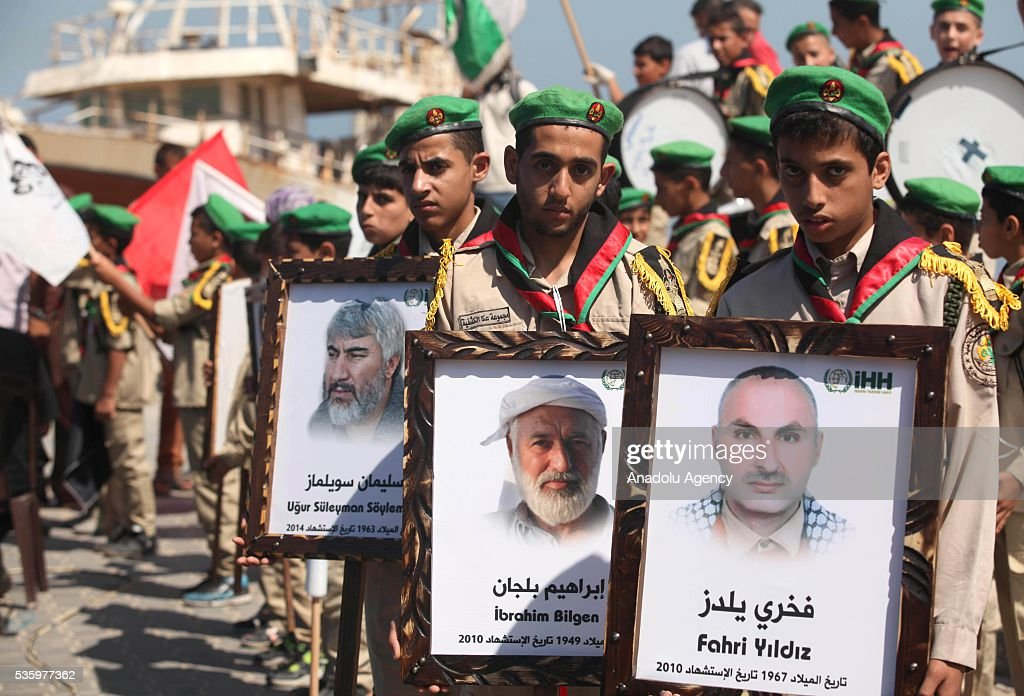 Palestinian children hold pictures of those who lost their lives in 2010 Mavi Marmara flotilla incident during a commemoration ceremony organized by IHH Humanitarian Relief Foundation, in Gaza City, Gaza on May 31, 2016.