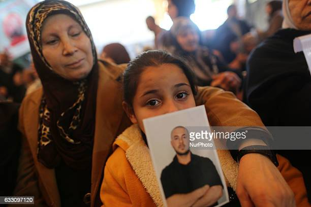 Palestinian children hold their relatives pictures during a a demonstration in support of their relatives held in Israeli prisons in front of the...