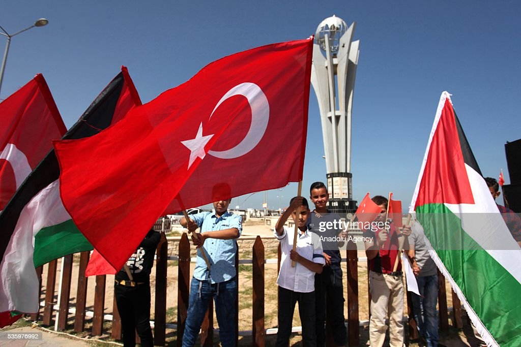 Palestinian children hold Turkish and Palestinian flags during a commemoration ceremony organized by IHH Humanitarian Relief Foundation for those who lost their lives in 2010 Mavi Marmara flotilla incident, in Gaza City, Gaza on May 31, 2016.