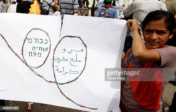 Palestinian children participate during a rally in Rafah in the southern Gaza Strip to show solidarity with Palestinian prisoners held in Israeli...