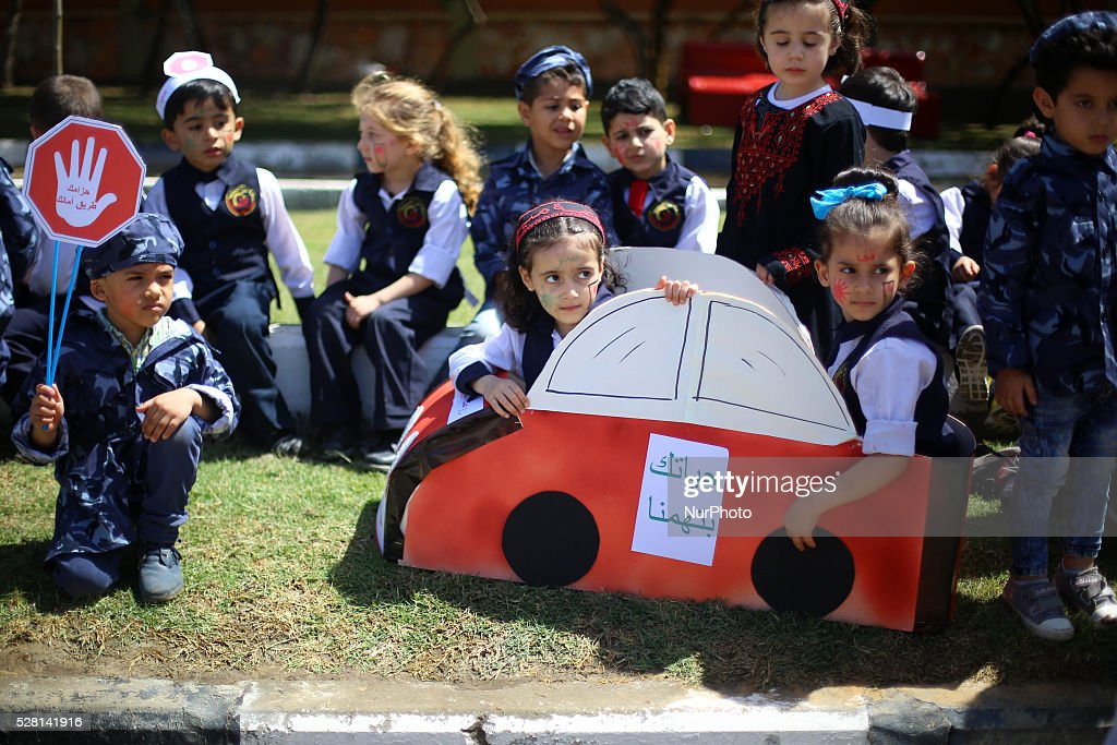 Palestinian children participate in a rally International Day of Traffic in Gaza City , on May 4, 2016