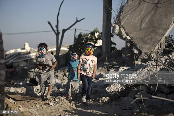 Palestinian children play in the rubble of buildings reportedly destroyed during the 50day war between Israel and Hamas militants in the summer of...