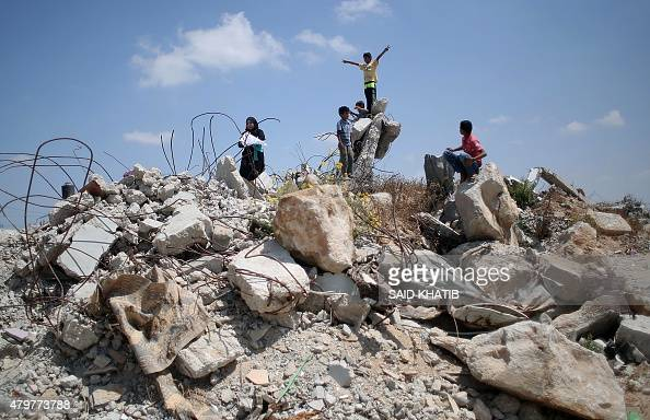 Palestinian children play in the rubble of houses destroyed during the 50day war between Israel and Hamas militants in the summer of 2014 in the...