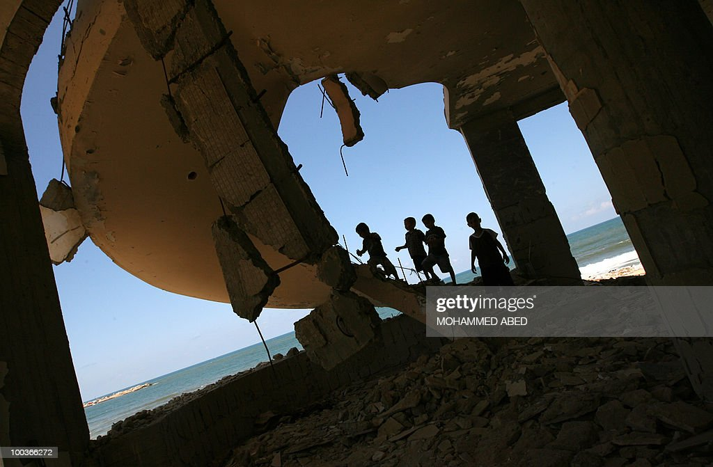 Palestinian children play inside a building destroyed during the previous Israeli offensive in Gaza City on May 24, 2010. A U.N. agency reported yesterday that three-quarters of the damage inflicted on Gaza by Israel's war on Hamas more than a year ago has not been repaired or rebuilt.
