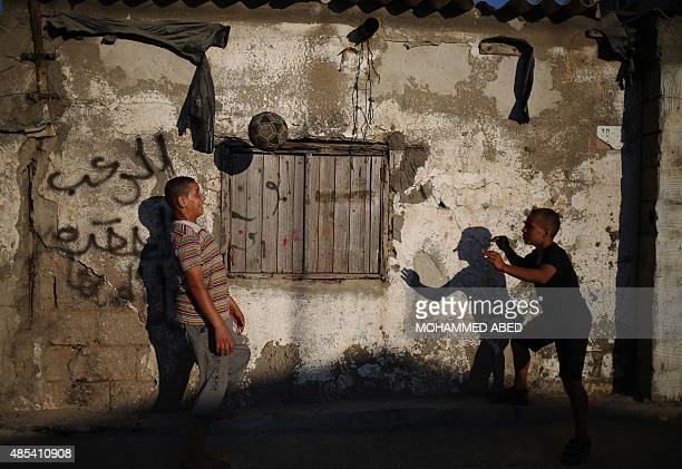 Palestinian children play next to their house at the AlShatee refugee camp in Gaza City on August 27 2015 AFP PHOTO / MOHAMMED ABED