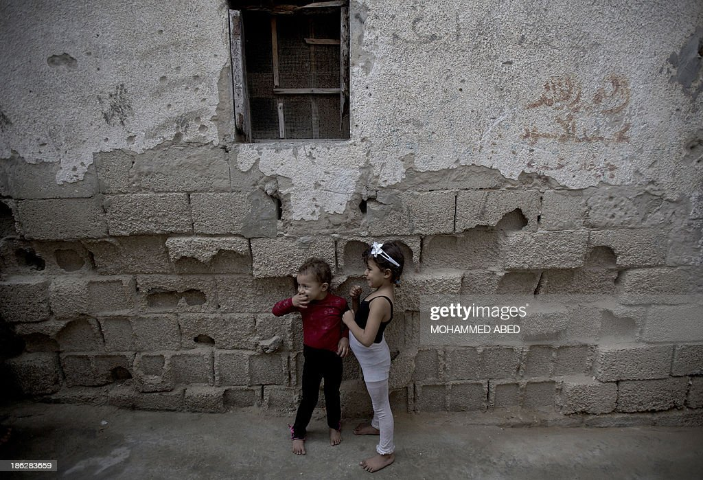 Palestinian children play outside their house in al-Shatee refugee camp in Gaza City, on October 30, 2013.