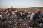 Palestinian children sift through a garbage dump on November 7 2012 south of Hebron West Bank About 40 Palestinain men and children work at the West...