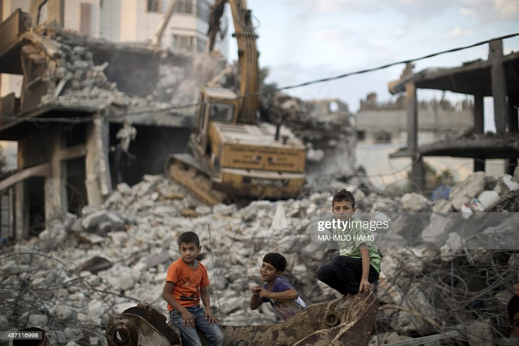 Palestinian children stand in the rubble of destroyed homes and buildings from the 50day conflict between Hamas militants and Israel in Shejaiya...