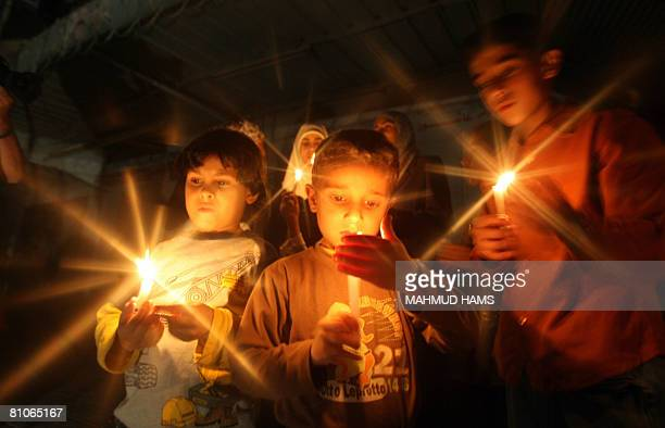 Palestinian children take part in a candlelight rally in Gaza City on May 10 2008 Gaza plunged into darkness after the only power station stopped due...