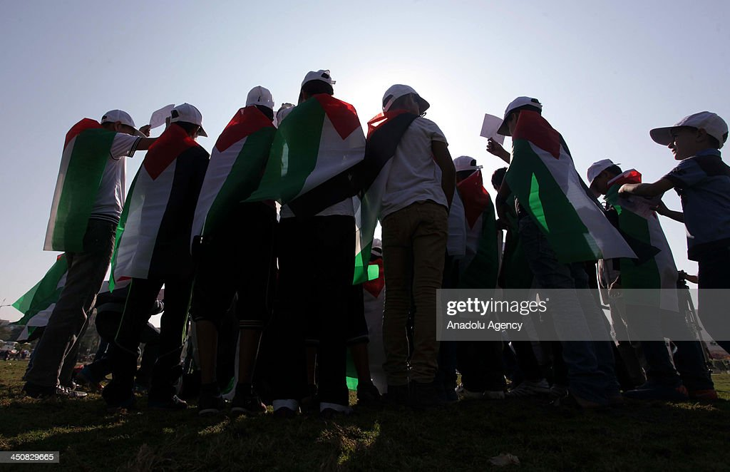 Palestinian children take part in a marathon, marking 'Universal Children's Day' in Gaza City on November 20, 2013. Around 200 children participated in the marathon calling for peace and end the blockade on Gaza Strip.