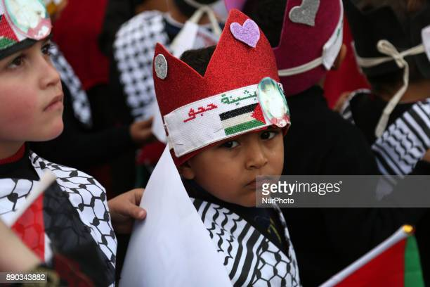 Palestinian children take part in a protest against Trump's decision to recognize Jerusalem as the capital of Israel in Gaza City December 11 2017