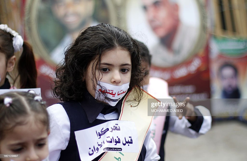 Palestinian children take part in a protest in solidarity with Palestinian prisoners held in Israeli jails in Gaza City on February 19, 2013. Some 800 Palestinians serving time in Israeli jails were refusing food in solidarity with four fellow inmates who have been on long-term hunger strike, officials said. AFP PHOTO/MOHAMMED ABED