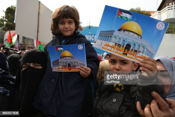 Palestinian children take part in a protest next to the offices of UNSCO against US President Donald Trump's decision to recognise Jerusalem as the...
