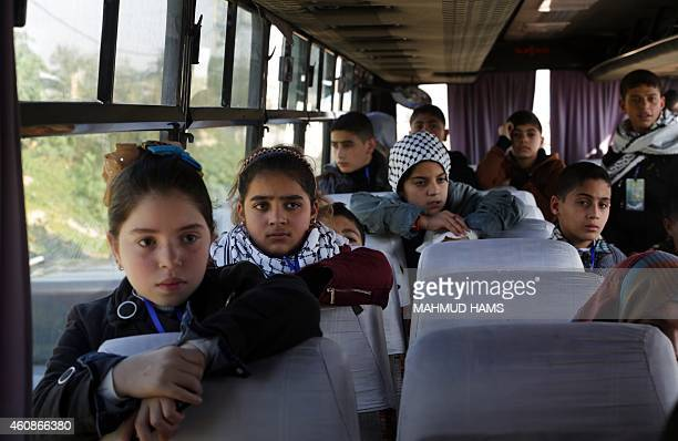 Palestinian children wait on a bus at Erez crossing in Beit Hanun in the north of the Gaza Strip on December 28 before being prevented by Hamas from...