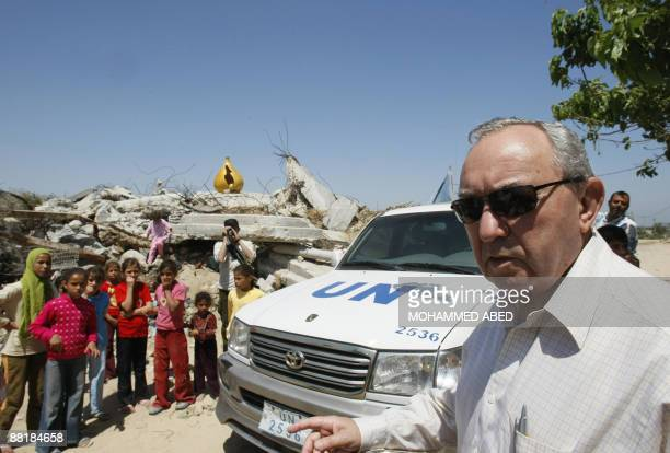 Palestinian children watch as UN lead investigator Richard Goldstone arrives to inspect the destruction at the Samuni family home in Gaza City on...