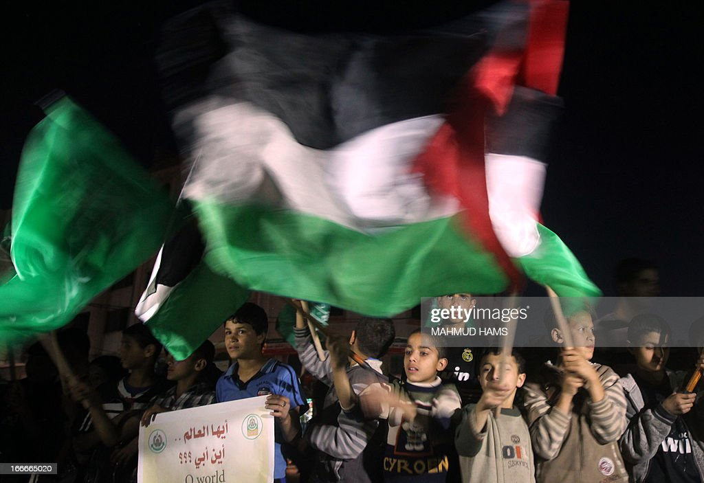 Palestinian children wave their national flag during a gathering to show solidarity with Palestinian prisoners held in Israeli jails, on April 15, 2013 in Gaza City. Human rights violations by medics working for Israel's prison service are endangering the lives of both Israeli and Palestinian inmates, especially hunger strikers, a watchdog said on April 11.