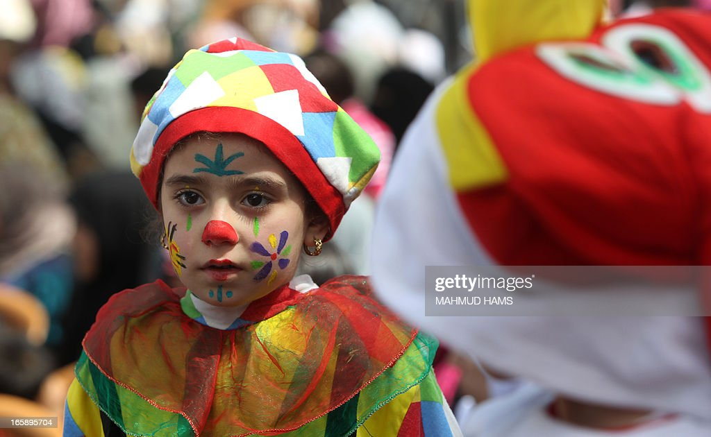 Palestinian children wear costumes during the Children's Fund festival at the Community College of the Islamic University of Gaza in Gaza city on April 7, 2013.